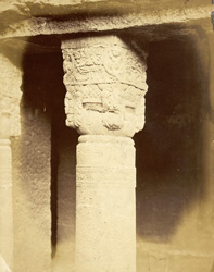 Pillar in front of chapel at right of verandah of Buddhist Chaitya Hall, Cave XIX, Ajanta